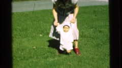 1951: woman helping small child walk CHATHAM, NEW JERSEY Stock Footage
