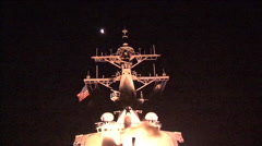 A U.S. Navy ship launches Tomahawk missiles towards Libyan targets Stock Footage