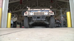 Military vehicle drives directly over camera. Stock Footage