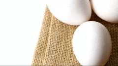 White eggs rotating on a burlap bag Stock Footage