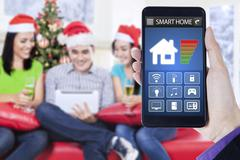 Smart home controller and three teenager Stock Photos