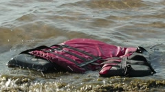 Life Jacket Floating On The Shore Stock Footage