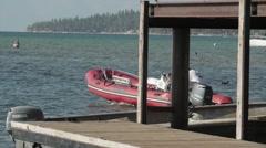 Slow Motion Motor Boat Leaving Dock Stock Footage