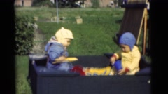 1951: kids wearing cute dresses in the tub playing with bucket and mug CHATHAM, Stock Footage