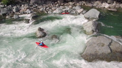 Drone Shot of Kayaker Charging Down Raging River on Sunny Day Stock Footage