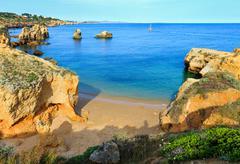 Yellow cliffs on beach (Algarve, Portugal). Stock Photos