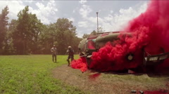 Soldiers explore a downed helicopter during a field training exercise. Stock Footage