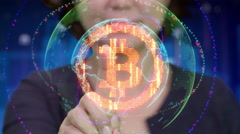Young Asian female touches futuristic interface to activate Bitcoin icon Stock Footage