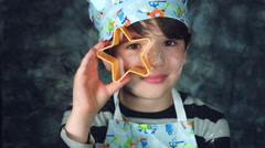 4k Colourful Shot of a Cook Child Holding Start Biscuit Shape Stock Footage