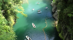 Aerial shot of Takachiho Gorge and moving boats, Miyazaki, Japan Stock Footage