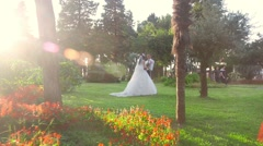 Bride and groom in batumi boulevard Stock Footage