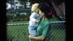 1951: a pretty young mom outside holding her baby CHATHAM, NEW JERSEY Stock Footage