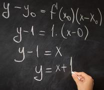 Math class on blackboard Stock Photos