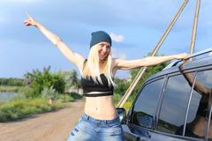 Young beautiful woman sport shows press on the stomach workout training results Kuvituskuvat