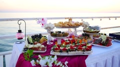 Buffet table at sunset Stock Footage
