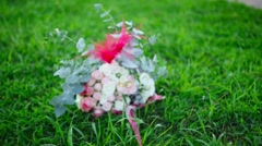 The bride's bouquet on the grass Stock Footage