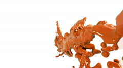 Flying orange fluid stream in slow motion DOF. Colored paint Stock Footage
