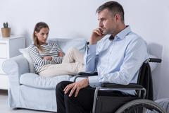 Hard relation with a disabled partner Stock Photos