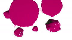 Pink drops falls and spreads on white. Colored paint Stock Footage