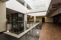 Interesting combination of materials diversifies space of corridor Stock Photos