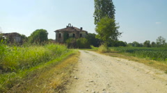 Approaching a creepy abandoned house in the countryside Stock Footage