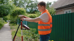 Worker prepare geodetic device for surveying Stock Footage