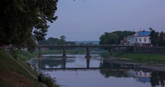 Small City River With Pedestrian Bridge, Transition From Day to Night (Time Stock Footage
