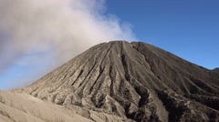 View of smoking active volcano Batok in Indonesia Stock Footage