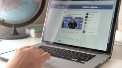 Facebook internet website on Apple Macbook display Stock Footage