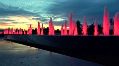 Modern red lit park fountains at late sunset. Architectural LED lighting. 4K Stock Footage