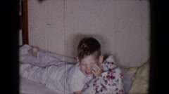 1958: the boy playing on bed with the magical pillow go crazily TUCSON, ARIZONA Stock Footage