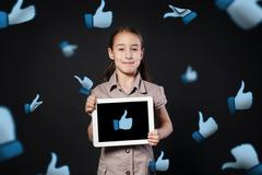 Children addiction to social networks. Little girl with tablet Stock Photos