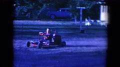 1958: child having fun driving red go kart in yard TUCSON, ARIZONA Stock Footage