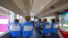 Tourists in a citysightseeing tourist bus Stock Footage