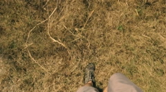 Feet of a man walking fast in the countryside Stock Footage