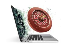 The concept of online casinos, takes off from the laptop isolated on white Piirros