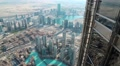 Top view on Dubai from glass window on 124th floor of Burj Khalifa skyscraper HD Footage