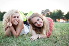 Two lovely girls enjoying a quality time in park at sunset. Stock Photos