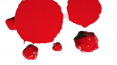 Red drops falls and spreads on white. Colored paint Stock Footage