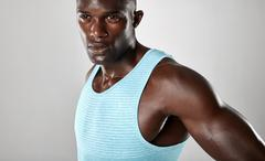 Confident young african man with muscular build Stock Photos