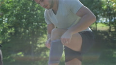 A young man putting a knee support Stock Footage