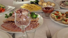 Table in the restaurant with meat dishes and snacks Stock Footage
