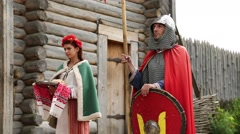 Woman and knight in armours in Kyivan Rus park, Kopachiv village, Ukraine Stock Footage