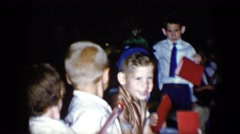 1958: a group of well dressed small children in a row of seats with red folders Stock Footage