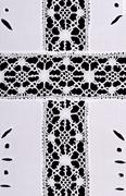 Latin cross motif in whitework embroidery linen tablecloth Stock Photos