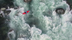 Overhead Aerial Shot of Man in Kayak on Raging River with Rapids Stock Footage