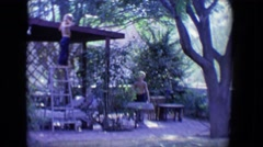 1958: two children active in a courtyard with trees and facilities TUCSON, Stock Footage