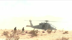 Alaska air National Guard practice a war casualty airlift rescue in the desert. Stock Footage