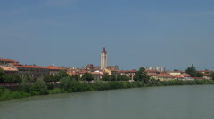 Adige river with tower of Anastasia  church in Verona Stock Footage