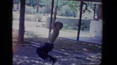 1958: boy swings from a rope on a tree TUCSON, ARIZONA Stock Footage